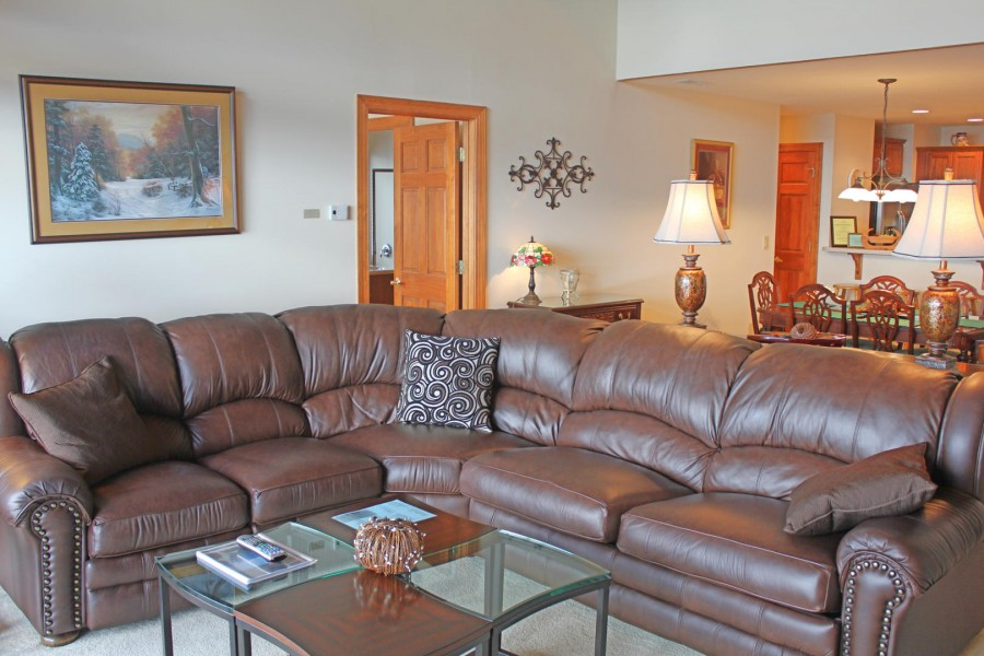 Big couch in living room of Sugar Mountain vacation rental.