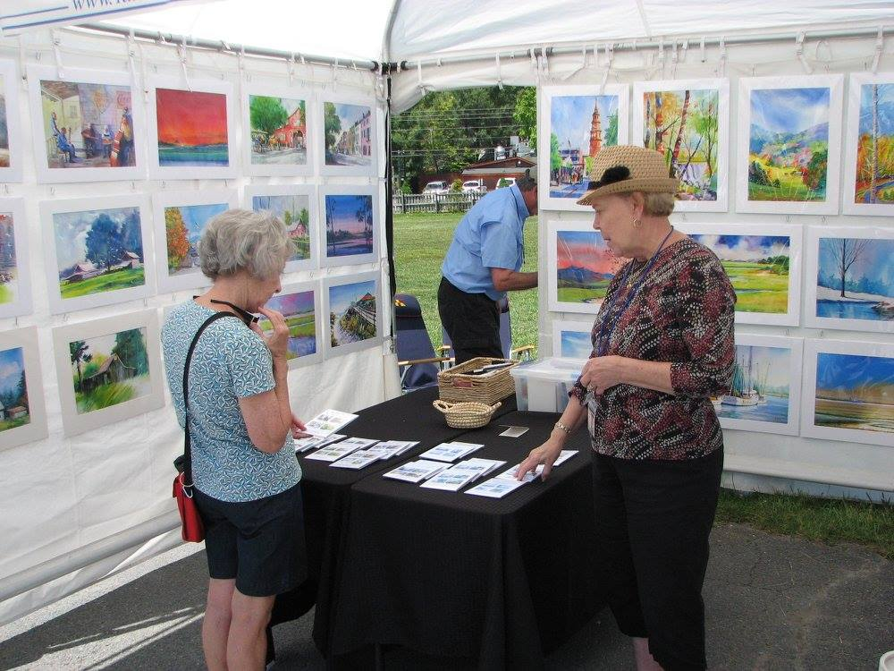 Ladies discussing art at the Art on the Greene Event in Banner Elk, NC